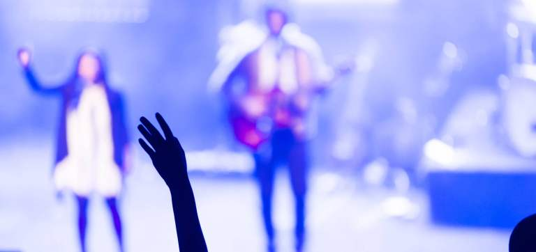 Woman raising arm in modern church